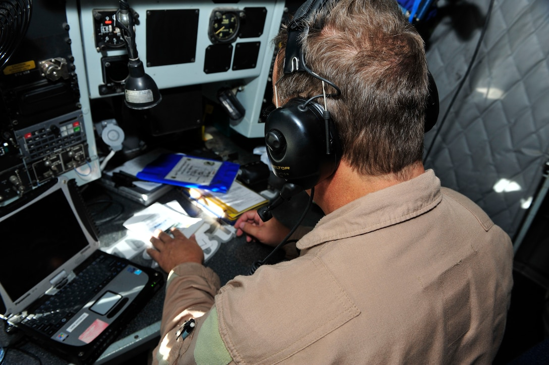 Senior Master Sgt. Floyd W. Atkins performs preflight checklists at Al Udeid Air Base, Qatar, July 17, 2014. The pilots and boom operator all go through preflight checks to ensure all systems are operating properly and the aircraft is mission ready prior to takeoff. Atkins's reached his 8,000th refueling hour during the mission. Atkins is 340th Expeditionary Air Refueling Squadron boom operator. (U.S. Air Force photo/Senior Airman Colin Cates)