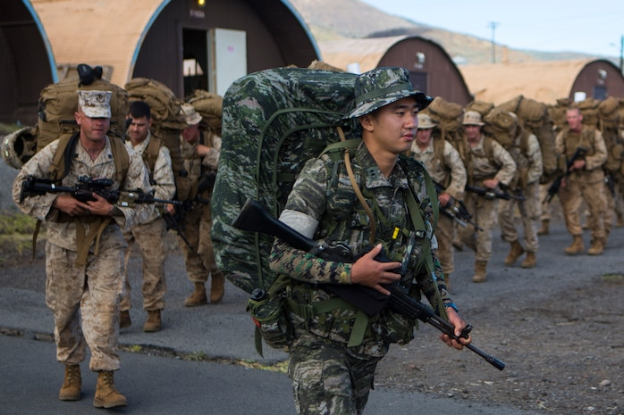 POHAKULOA TRAINING AREA, Hawaii - A Republic of Korea marine departs with Combined Landing Team 3 from base camp on a 15 km hike to Range 1 to stage for upcoming training during the Rim of the Pacific (RIMPAC) Exercise 2014 at Pohakuloa Training Area, Hawaii, July 18, 2014. Combined Landing Team 3 will participate in numerous ranges to further enhance their capability and proficiency while attending PTA. Twenty-two nations, more than 40 ships and submarines, about 200 aircraft and 25,000 personnel are partcipating in RIMPAC from June 26 to Aug. 1 in and around the Hawaiian Island and Southern California. The world's largest international maritime exercise, RIMPAC provides a unique training opportunity that helps foster and sustain the cooperative relationships that are critical to ensuring the safety of sea lanes and security on the world's oceans. RIMPAC 2014 is the 24th exercise in the series that began in 1971. (U.S. Marine Corps photo by Lance Cpl. Wesley Timm/Released)
