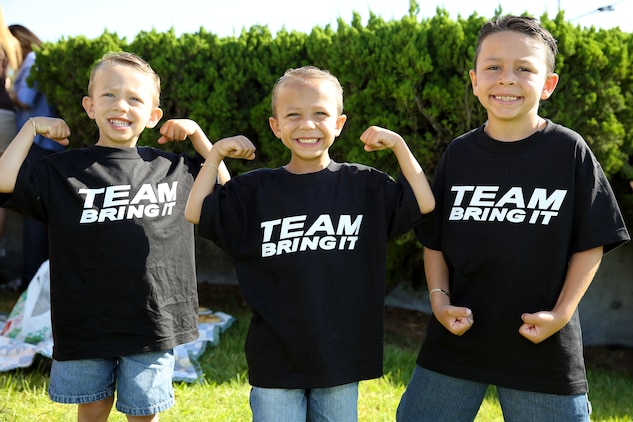 """Grayson, 4, Tristan, 6, and Aiden, 8, showed off their best """"Rock"""" poses as they awaited his arrival at the base theater July 24.  Actor Dwayne """"The Rock"""" Johnson visited Camp Pendleton for a screening of his new movie """"Hercules"""" and to conduct a meet and greet with fans."""