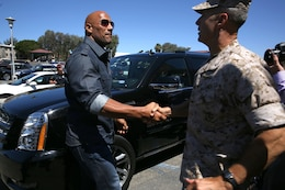 "Actor Dwayne ""The Rock"" Johnson meets with Brig. Gen. John W. Bullard upon his arrival at the base theater July 24.