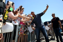 "Actor Dwayne ""The Rock"" Johnson took selfies with fans and signed autographs before the screening of his new movie ""Hercules"" at the base theater here July 24.