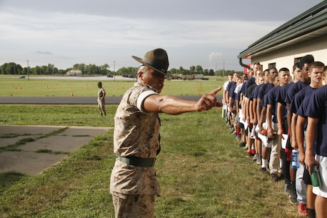Sergeant Rafael Garnica, a Company M, 3rd Recruit Training Battalion, Marine Corps Recruit Depot San Diego drill instructor, instructs poolees to move closer to one another during Marine Corps Recruiting Station Kansas City's all-hands pool function at Camp Clark in Nevada, Mo., June 20, 2014. Drill Instructors from both MCRD San Diego and Parris Island participated in the pool function to give poolees their first taste of what to expect at recruit training.