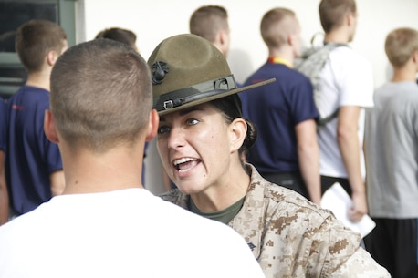 "Sergeant Lindsey Rodriguez, a Company O, 4th Recruit Training Battalion, Marine Corps Recruit Depot Parris Island drill instructor, instructs a poolee to clarify his response to her as ""ma'am"" whenever he walks past at Recruiting Station Kansas City's all-hands pool function at Camp Clark, June 20, 2014."