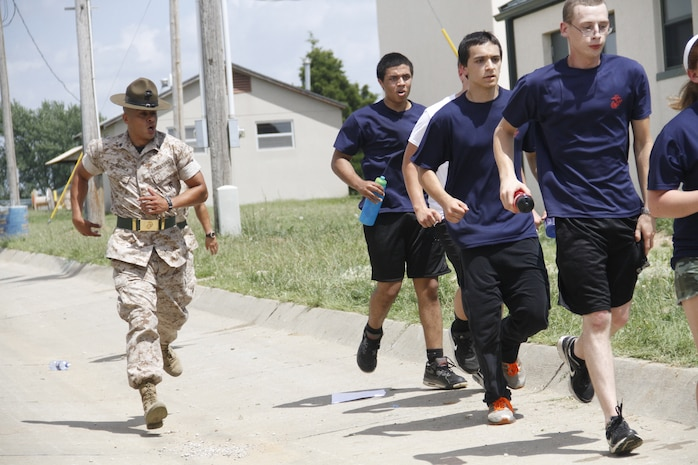 Sergeant Rafael Garnica, a Company M, 3rd Recruit Training Battalion, Marine Corps Recruit Depot San Diego drill instructor, hustles poolees to their next location during Recruiting Station Kansas City's all-hands pool function at Camp Clark in Nevada, Mo., June 20, 2014. Garnica, and other drill instructors from MCRD San Deigo and Parris Island were on hand to give poolees their first tast of what to expect when at recruit training.