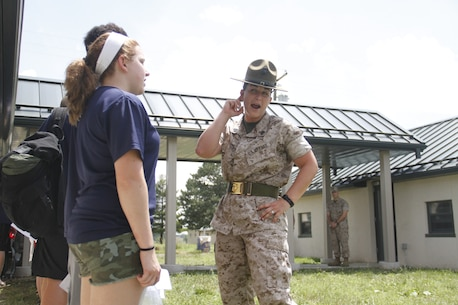 Sergeant Lindsey Rodriguez, a Company O, 4th Recruit Training Battalion, Marine Corps Recruit Depot Parris Island drill instructor, waits to hear increased volume from poolees during Recruiting Station Kansas City's all-hands pool function at Camp Clark in Nevada, Mo., June 20, 2014.