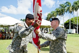 Col. Jeffrey L. Milhorn (r) receives the Army Colors from Lt. Gen. Thomas P. Bostick, during a Change-of-Command ceremony, July 18, on Palm Circle, Fort Shafter. Milhorn became the 31st commander of the Army Corps' Pacific Ocean Division.