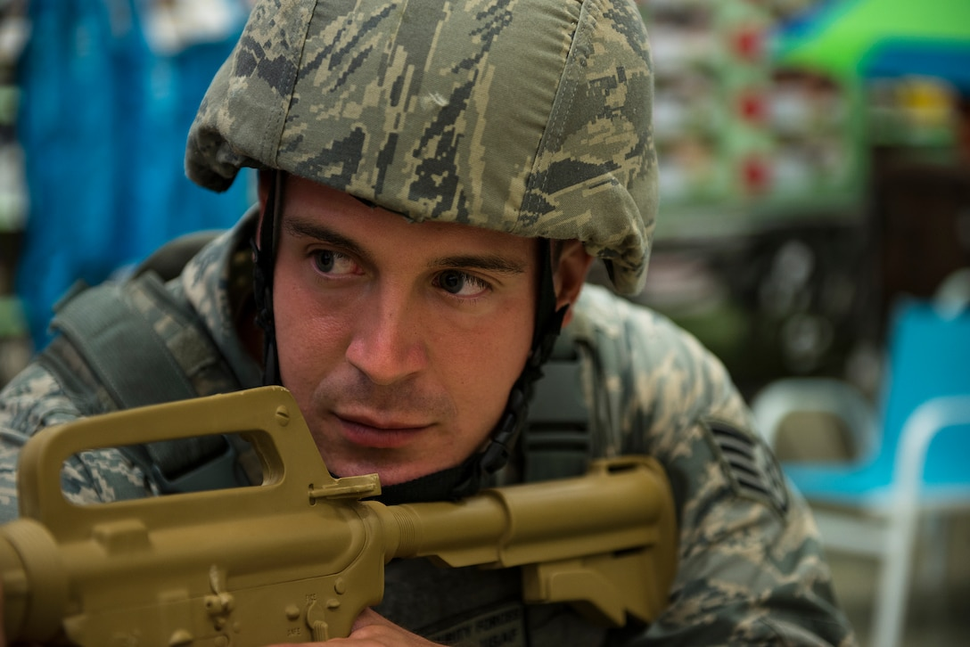 Staff Sgt. Joseph Kaczynski, 51st Security Forces Squadron emergency responder, surveys the scene during an active-shooter exercise July 24, 2014, at Osan Air Base, Republic of Korea. The scenario included two gunmen running through the Base Exchange. (U.S. Air Force photo by Staff Sgt. Jake Barreiro)