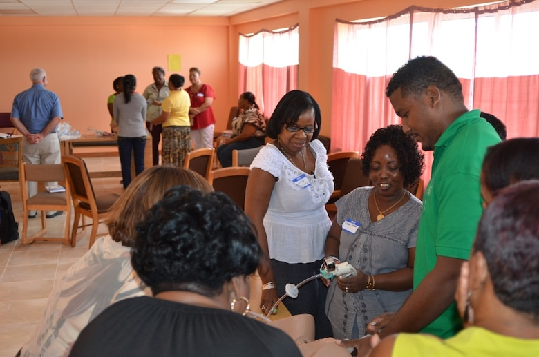 Belizean healthcare professionals practice performing assisted vaginal deliveries during the Global Advanced Life Support in Obstetrics Instructor Course in Belize City, Belize, July 23, 2014. (Courtesy Photo)
