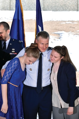 Brig. Gen. Evan Miller, the Academy's vice superintendent, hugs his daughters Maleah (left) and Audra (right), during his April promotion ceremony here. (U.S. Air Force photo/Liz Copan)