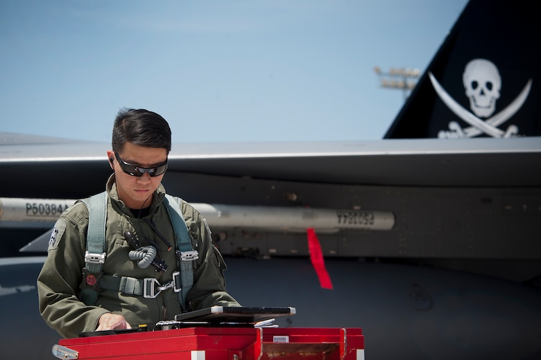 Republic of Singapore air force pilot assigned to the 366th Fighter Wing, 428th Fighter Squadron, Mountain Home Air Force Base, Idaho, reviews F-15SG aircraft maintenance forms as part of a pre-flight inspection prior to a Red Flag 14-3 training mission, July 18, 2014 at Nellis AFB, Nev.  Red Flag is a realistic combat exercise involving U.S. and allied air forces conducting training operations on the 15,000-square-mile Nevada Test and Training Range. (U.S. Air Force photo by Lawrence Crespo)