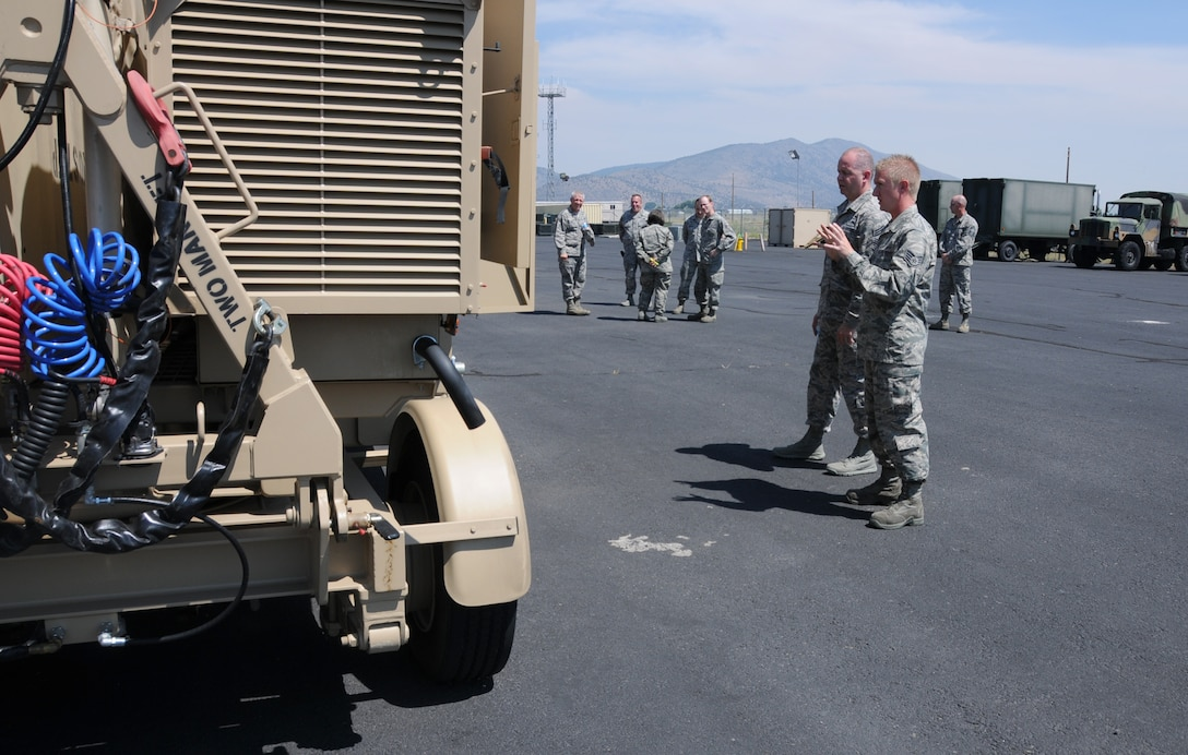 U.S. Air Force Staff Sgt. Mark Chinander, 270th Air Traffic Control Squadron, shows the Air National Guard Command Chief, James W. Hotaling, a new mobile Tactical Air Navigation system during Hotaling's visit to Kingsley Field, Klamath Falls, Ore. July 15, 2014. Hotaling spent the day meeting and speaking with the Airmen of the 173rd FW and 270th Air Traffic Control Squadron. (U.S. Air National Guard photo by Master Sgt. Jennifer Shirar/Released)
