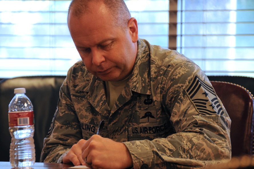 The Command Chief Master Sgt. of the Air National Guard, James W. Hotaling, takes notes during a meeting with the 173rd Fighter Wing Vice Commander, Col. Gregor Leist, during Hotaling's visit to Kingsley Field, Klamath Falls, Ore. July 15, 2014. Hotaling spent the day meeting and speaking with the Airmen of the 173rd FW and 270th Air Traffic Control Squadron. (U.S. Air National Guard photo by Master Sgt. Jennifer Shirar/Released)