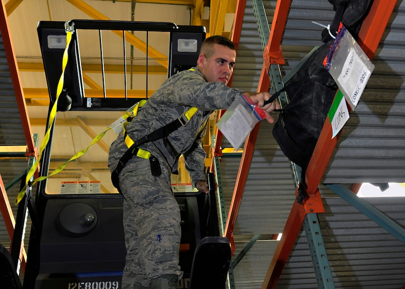 Airman 1st Class Jacob Lape, 39th Logistics Readiness Squadron material management journeyman, sorts mobility bags at the mobility warehouse July 22, 2014, Incirlik Air Base, Turkey. Mobility bags are kept on stand-by at all times in case of emergency. (U.S. Air Force photo by Staff Sgt. Eboni Reams/Released)