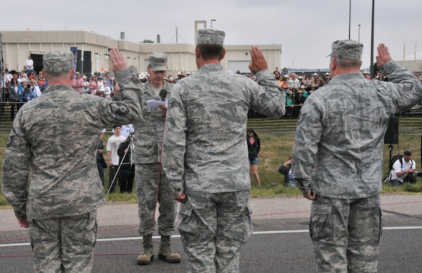 Lt. Gen. Stanley E. Clarke III, the director of the Air National Guard, administers the oath of enlistment during a mass re-enlistment ceremony, for airmen of the 153rd Airlift Wing on July 23, 2014. Clarke visited the 153rd, and met with unit and Wyoming National Guard leaders. (Air National Guard Photo By Staff.sgt  John Galvin)
