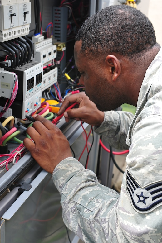 Staff Sgt. Chaddrick Webb, 8th Civil Engineer Squadron Heating, Ventilation, Air Conditioning and Refrigeration shop craftsman, uses a volt meter to troubleshoot the voltage of a malfunctioning circuit board at Kunsan Air Base, Republic of Korea, July 23, 2014. Specialized tools and training help 8th CES HVAC Airmen make the necessary repairs to cooling units needed to keep mission essential facilities and equipment cool and ready for use. (U.S. Air Force photo by 1st Lt. Earon Brown/Released)