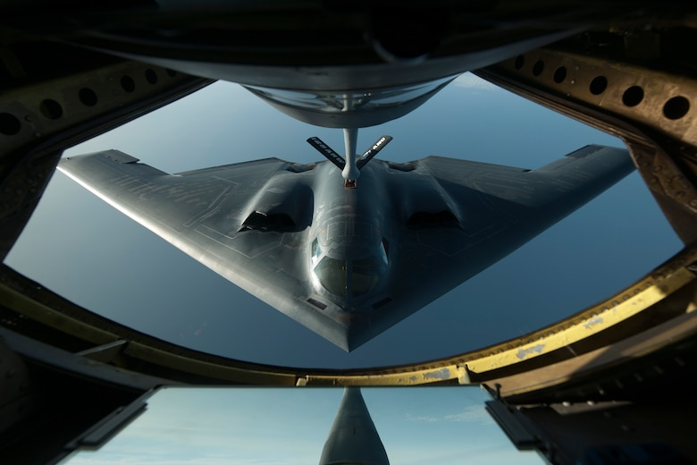 A B-2 Spirit flies into position June 11, 2014, during a refueling mission over the North Atlantic Ocean. The B-2 is conducting training flights and regional familiarization in the U.S. European Command area of operations. The B-2 is a multi-role bomber capable of delivering both conventional and nuclear munitions. (U.S. Air Force photo/Tech. Sgt. Paul Villanueva II)