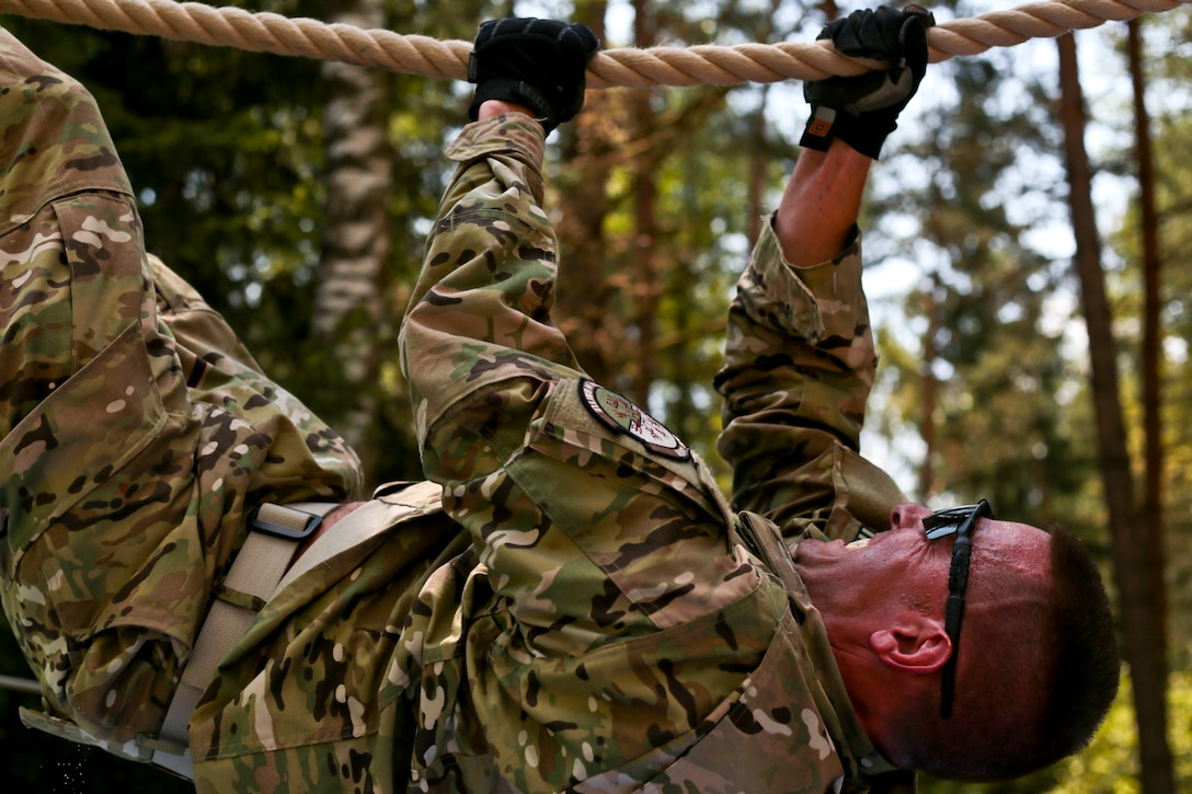 Tech. Sgt. Joe Lovanisci climbs the inverted rope challenge July 17, 2014, on an obstacle course at the Grafenwoehr Training Area, Germany.  Airmen from the New Jersey Air National Guard's 177th Fighter Wing and the Idaho ANG's 124th Fighter Wing ran the obstacle course as part of Operation Kriegshammer, a joint training mission for tactical air control party members, security forces specialists, and force support Airmen. Lovanisci is assigned to the 227th Air Support Operations Squadron, located on Atlantic City Air National Guard Base, N.J. (U.S. Air National Guard photo/Tech. Sgt. Matt Hecht)