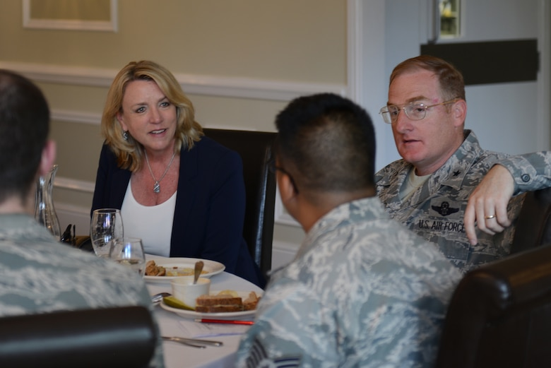 Secretary of the Air Force Deborah Lee James and Brig. Gen. Douglas Cox speak with Airmen from the 501st Combat Support Wing at lunch July 17, 2014, during a visit to Royal Air Force Alconbury, England. More than fifty Airmen had the chance to sit and speak with James during lunch, explaining their parts of the mission of the 501st CSW. Cox is the director of U.S. Air Forces in Europe-United Kingdom. (U.S. Air Force photo/Tech. Sgt. Chrissy Best)