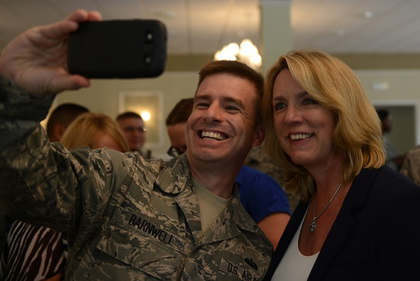 Secretary of the Air Force Deborah Lee James takes a selfie with Tech. Sgt. Michael Barnwell July 17, 2014, at Royal Air Force Alconbury, England. James visited RAF Molesworth and RAF Alconbury two of seven 501st Combat Support Wing installations, and learned about the wing's mission directly from the Airmen who drive it. Barnwell is from the 422nd Communications Squadron. (U.S. Air Force photo/Tech. Sgt. Chrissy Best)