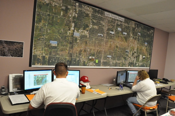 The Army Corps' GIS Cadre working at the Corps' Recovery Field Office in Joplin, Missouri after a multiple-vortex tornado struck Joplin on May 22, 2011.