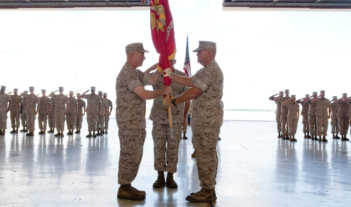 MACDILL AIR FORCE BASE, Fla. – Lt. Gen. Kenneth McKenzie (left), began his tenure as commander of U.S. Marine Corps Forces Central Command when he received the unit colors from his predecessor Lt. Gen. Robert Neller during a change of command ceremony here, June 18. (USCENTCOM photo by Sgt. Fredrick J Coleman, USMC)