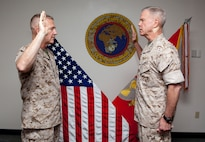 MACDILL AIR FORCE BASE, Fla. – Gen. John Amos, Commandant of the Marine Corps, administered the Officer Oath of Office to Lt. Gen. Kenneth McKenzie during his promotion ceremony here, June 18.  McKenzie later assume command of U.S. Marine Corps Forces Central Command during a change of command ceremony. (USCENTCOM photo by Sgt. Fredrick J Coleman, USMC)