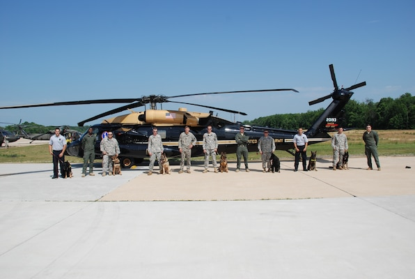 Members of the DIA K-9 police unit and the 12th Aviation Brigade stand together after a successful day of training.
