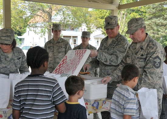 (From left) Tech. Sgt. Sara Eldred, Airman 1st Class Daniel Street, Airman 1st Class Elijah Hammond-Wood, Lt. Col. Ty Randall and Senior Master Sgt. Kevin Moughan hand out lunches to youth at Steinmetz Park in Schenectady, New York, July 25, 2014. About 30 Airmen from the 109th Airlift Wing volunteered throughout the week to help with Schenectady Inner City Ministry's Summer Lunch Program. The ministry has been providing free lunches to youth throughout Schenectady for 20 years. Eldred, Street, and Hammond-Wood are all with the 139th Aeromedical Evacuation Squadron; Randall is the 109th Civil Engineer Squadron commander; and Moughan is assigned to the 109th Maintenance Group. (U.S. Air National Guard photo by Tech. Sgt. Catharine Schmidt/Released)