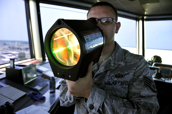 U.S. Air Force Staff Sgt. Joshua Batman,509th Operations Support Squadron air traffic controller, operates a light gun at Whiteman Air Force Base, Mo., July 10, 2014. The light gun is used to communicate safety and movement signals to individuals on the flightline. (U.S. Air Force photo by Airman 1st Class Keenan Berry/Released)