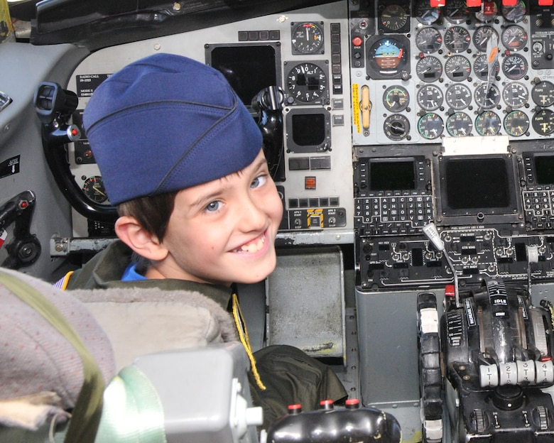 Eight-year-old Joey Fabus poses for a photo in the pilot seat of a KC-135 Stratotanker aircraft during his time as commander for a day at the 171st Air Refueling Wing here, July 17, 2014, fulfilling his childhood dream of joining the military. Joey, who was diagnosed with an inoperable brain tumor, spent the day with members, completing various activities designed for his special day, before being awarded the 171st Medal for Bravery.  (U.S. Air National Guard Photo by Major Karen Bogdan/Released)