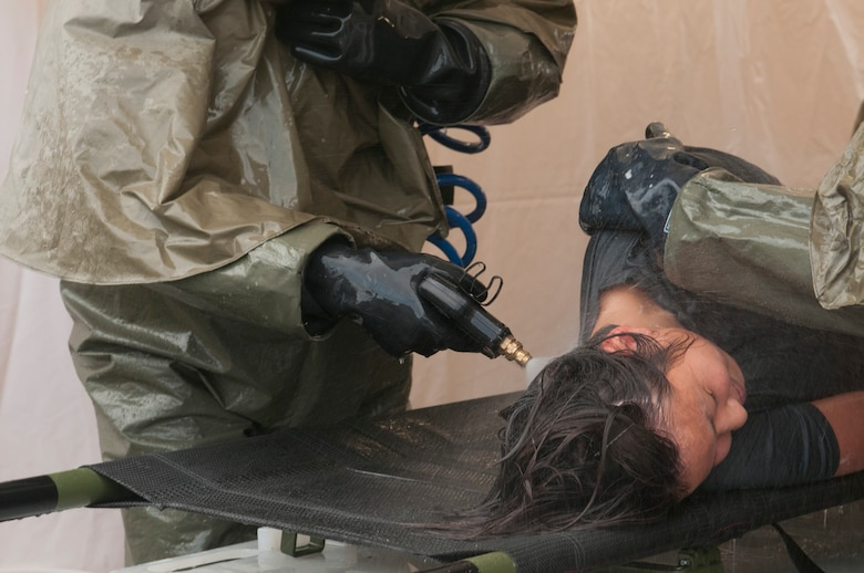 The 162nd Medical Group trains on In-Place Patient Decontamination, IPPD, July 15, 2014 at the wing medical facility. (U.S. Air National Guard photo by Senior Airman Gregory Ferreira/Released)