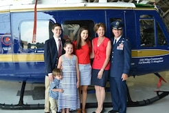 Col. Brad Hoagland poses with his wife, Jill, and their four kids at the 11th Wing change of command ceremony at Hangar 3, Joint Base Andrews, Md., July 14, 2014. Hoagland was previously the 386th Air Expeditionary Wing's vice commander in Southwest Asia. (Courtesy photo)