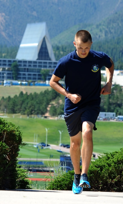 Airman 1st Class Dylan MacDermot trains Wednesday at the Academy for the 2014 Air Force marathon at Wright-Patterson AFB, Ohio, in September. He hopes to raise $2,500 for the Air Force Enlisted Village. (U.S. Air Force photo/Master Sgt. Kenneth Bellard)