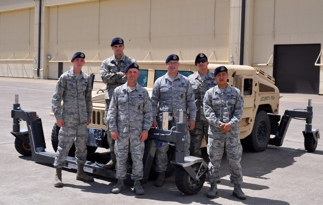 Security Forces Airmen pose with a skid trainer at Malmstrom Air Force Base, Montana, June 27. Three skid trainers were recently delivered to Air Force Global Strike Command to complement AFGSC's new driver safety program, familiarizing Airmen with the handling characteristics of the HMMWV in a wide variety of driving conditions.