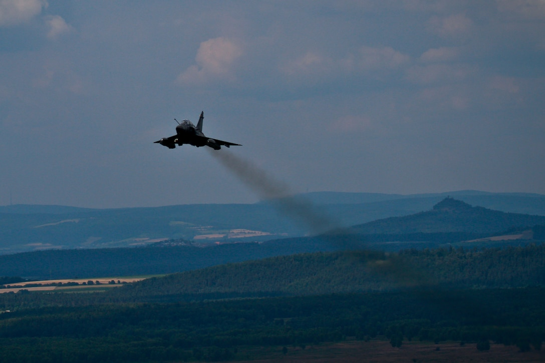 A French Air Force Mirage 2000, controlled by New Jersey Air National Guard Airmen, flies over Grafenwoehr Training Area, Bavaria, Germany on July 16, 2014 during Operation Kriegshammer.  (U.S Air National Guard photo by Tech. Sgt. Matt Hecht/Released)
