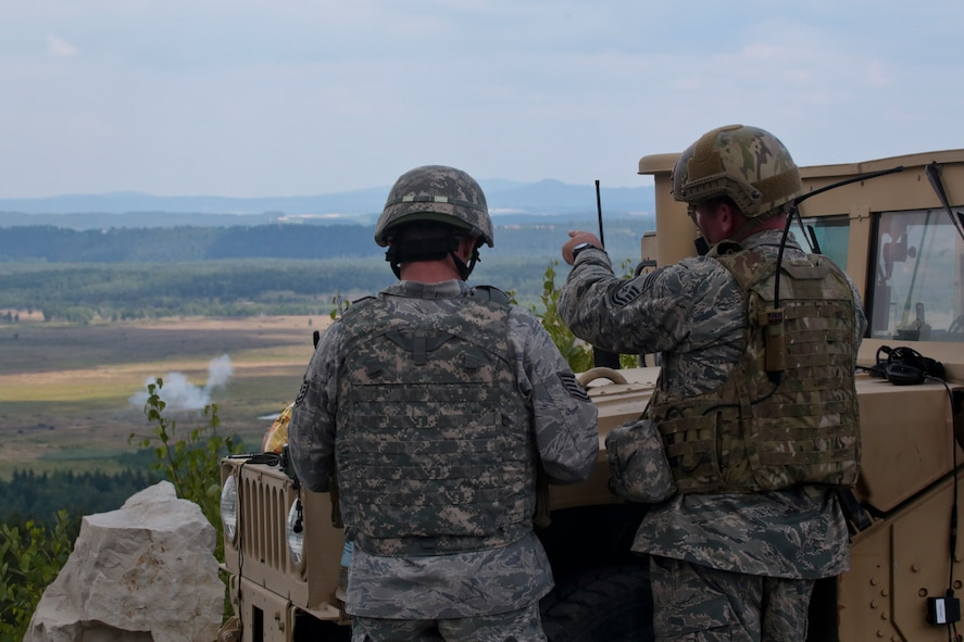 U.S. Air Force Chief Master Sgt. Robert Zaniewski, right, points out a direct hit to Tech. Sgt. Jack Baum after coordinating emergency close air support from a German Air Force Tornado on July 16, 2014 at Grafenwoehr Training Area, Bavaria, Germany.  Zaniewski is the superintendent of the New Jersey Air National Guard's 227th Air Support Operations Squadron, and Baum is assigned to the 177th Security Forces Squadron.  (U.S Air National Guard photo by Tech. Sgt. Matt Hecht/Released)