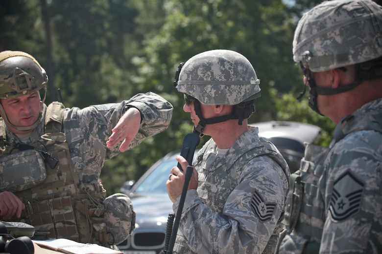 U.S. Air Force Chief Master Sgt. Robert Zaniewski, left, explains emergency close air support procedures to Airmen from the 177th Security Forces Squadron on July 16, 2014 at Grafenwoehr Training Area, Bavaria, Germany.  Zaniewski is the superintendent of the New Jersey Air National Guard's 227th Air Support Operations Squadron.  (U.S Air National Guard photo by Tech. Sgt. Matt Hecht/Released)