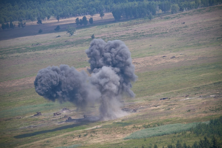 Bombs dropped from a U.S. Air Force F-16 Fighting Falcon supporting Air National Guard airmen from the 177th Security Forces Squadron impact targets at Grafenwoehr Training Area, Bavaria, Germany on July 16, 2014 during Operation Kriegshammer. Operation Kriegshammer is a joint training mission, and this portion featured training in emergency close air support.  (U.S Air National Guard photo by Tech. Sgt. Matt Hecht/Released)