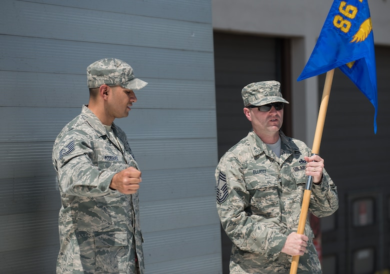 Tech. Sgt. Raul Rodriguez, 86th Airlift Wing protocol member, helps position Chief Master Sgt. Paul Elliott, 86th Logistics Readiness Group command chief, during a change of command dry-run July 17, 2014, at Ramstein Air Base, Germany. The wing protocol office is made up of four Airmen who provide support to approximately 22,000 military members and Department of Defense civilians. (U.S. Air Force photo/Senior Airman Jonathan Stefanko)