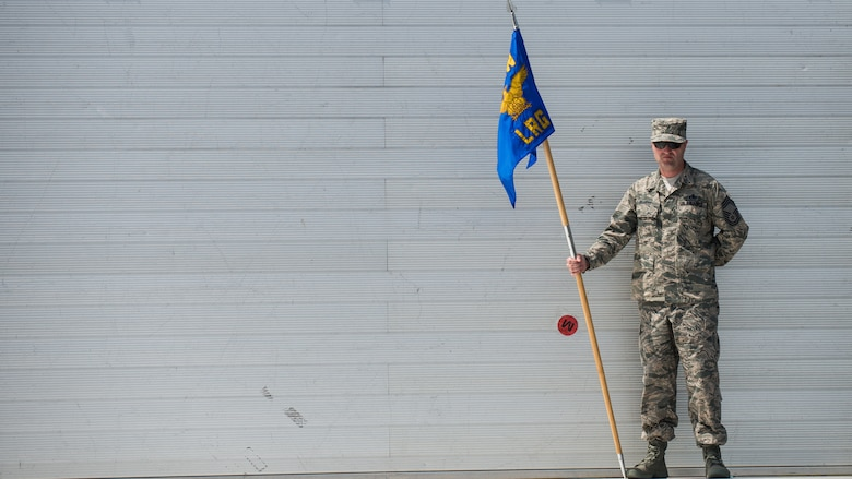 Chief Master Sgt. Paul Elliott, 86th Logistics Readiness Group command chief, gets into place during a change of command dry-run with the 86th Airlift Wing protocol team July 17, 2014, at Ramstein Air Base, Germany. The wing protocol office is made up of four Airmen who provide support to approximately 22,000 military members and Department of Defense civilians. (U.S. Air Force photo/Senior Airman Jonathan Stefanko)