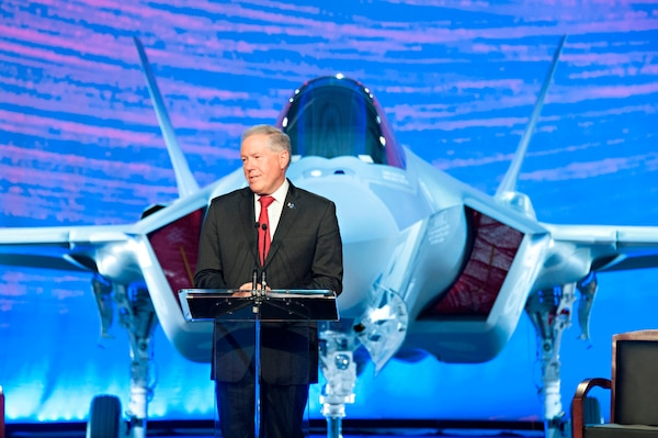 Frank Kendall, undersecretary of defense for acquisition, technology and logistics, speaks at a roll-out ceremony for the first two F-35 Lightning II joint strike fighter aircraft for the Royal Australian Air Force at Lockheed Martin in Fort Worth, Texas, July 24, 2014. Kendall said the aircraft represents an exponential leap in capability on the cutting edge of technology, and is an integral component of the ongoing U.S. and Australian commitment to stability in the Asia-Pacific region. Courtesy photo