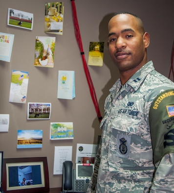 U.S. Air Force Capt. Kenneth Canty, 386th Expeditionary Security Forces, operations officer, poses in front of cards that his grandmother sent to him throughout his deployment to a base in Southwest Asia July 25, 2014. Canty deployed from MacDill Air Force Base, Florida, in support of Operation Enduring Freedom and is a Miami native. (U.S. Air Force photo by Senior Master Sgt. Allison Day)