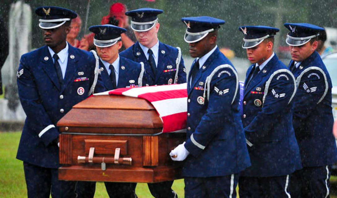 Capt. Robert Turnbull Sr.'s remains are carried by members of the Tyndall Air Force Base Honor Guard during his funeral July 19, 2014, at Barnetts Creek Baptist Church Cemetery, Thomas County, Ga. Trunbull was one of 52 service members lost during a C-124 Globemaster crash in Alaska in 1952. (U.S. Air Force photo/Airman 1st Class Dustin Mullen)