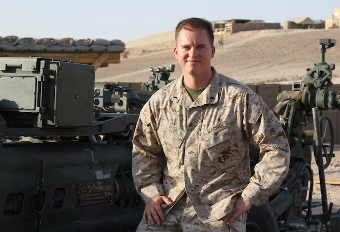 """First Lt. Michael Wish, a native of Colorado Springs, Colo., and executive officer of Tango Battery, 5th Battalion, 11th Marine Regiment, poses for a photo next to an M777 Howitzer nicknamed """"Death Wish,"""" aboard Camp Bastion, Helmand province, Afghanistan, July 21, 2014. Wish deployed to Helmand during 2012 and served in Now Zad. During his current deployment, Tango Battery has provided additional security for coalition forces during the Helmand drawdown as forces prepare to retrograde and redeploy by the end of 2014."""