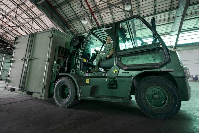 U.S. Air Force Staff Sgt. Robert Nine, assigned to the 169th Communications Flight, drives a 10k standard forklift during forklift driver training at the Combat Readiness Training Center in Savanah, Ga., July 16, 2014. Nine and more than 180 Airmen from the 169th Fighter Wing, traveled to the CRTC to conduct their annual training. The CRTC offered the Airmen a place to train and complete yearly ancillary training away from their home station.  (U.S. Air National Guard photo by Tech. Sgt. Jorge Intriago/Released)