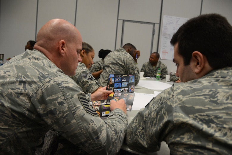 U.S. Airmen, assigned to the 169th Fighter Wing, attend a Four Lenses personality-type indicator assessment, during annual training at the Combat Readiness Training Center in Savannah, G.a., July 16, 2014.  This training experience has allowed Airmen to meet their annual requirements outside of the unit training assembly weekend throughout the year.  (U.S. Air National Guard photo by Tech. Sgt. Jorge Intriago/Released)