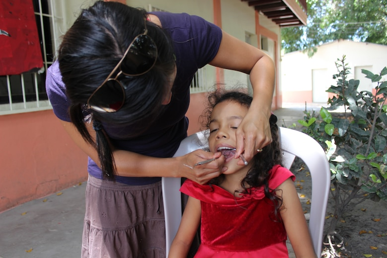 Joint Task Force-Bravo's Medical Element (MEDEL) provide dental care for the Hogar de Niños Nazareth, a girls orphanage, July 20, 2014. The girls receive much needed preventative dental healthcare such as oral hygiene instructions, sealants, and fluoride treatments with supplies bought and donated by MEDEL service members.  (Photo by U. S. Army Sgt. Catherine Tharpe)