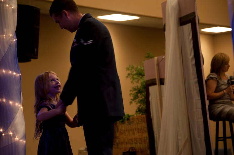 Airman 1st Class Steven Pippin, a military volunteer from Maxwell Air Force Base, dances with a pageant participant at the Alabama Angels Pageant July 26, 2014. The pageant recognizes special needs people of all ages for their abilities rather than disabilities. Each participant is crowned with a title reflecting something unique about them. (U.S. Air Force photo by Staff Sgt. Natasha Stannard)