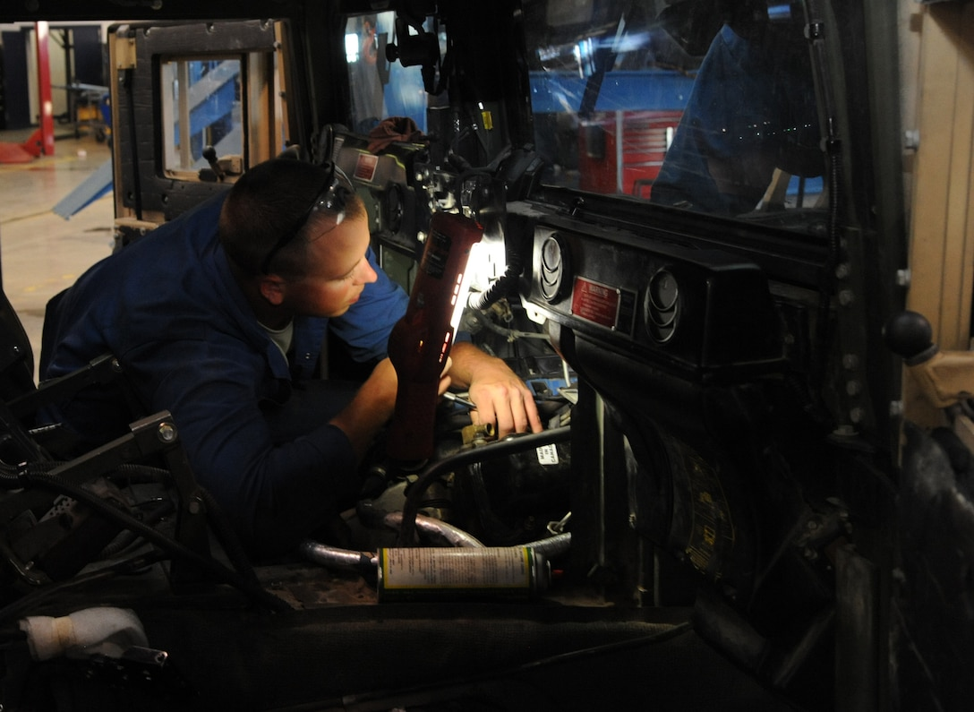 Senior Airman Hunter Dombek, 341st Logistics Readiness Squadron vehicle mechanic, replaces a passenger side valve cover gasket/intake gaskets and turbo charger seals on a 6.5-liter diesel engine July 23. When junior airmen first arrive to the vehicle maintenance shop, they are tasked with performing the novice jobs such as oil changes, filter changes, and pressure washing the vehicles. (U.S. Air Force photo/Airman 1st Class Joshua Smoot)