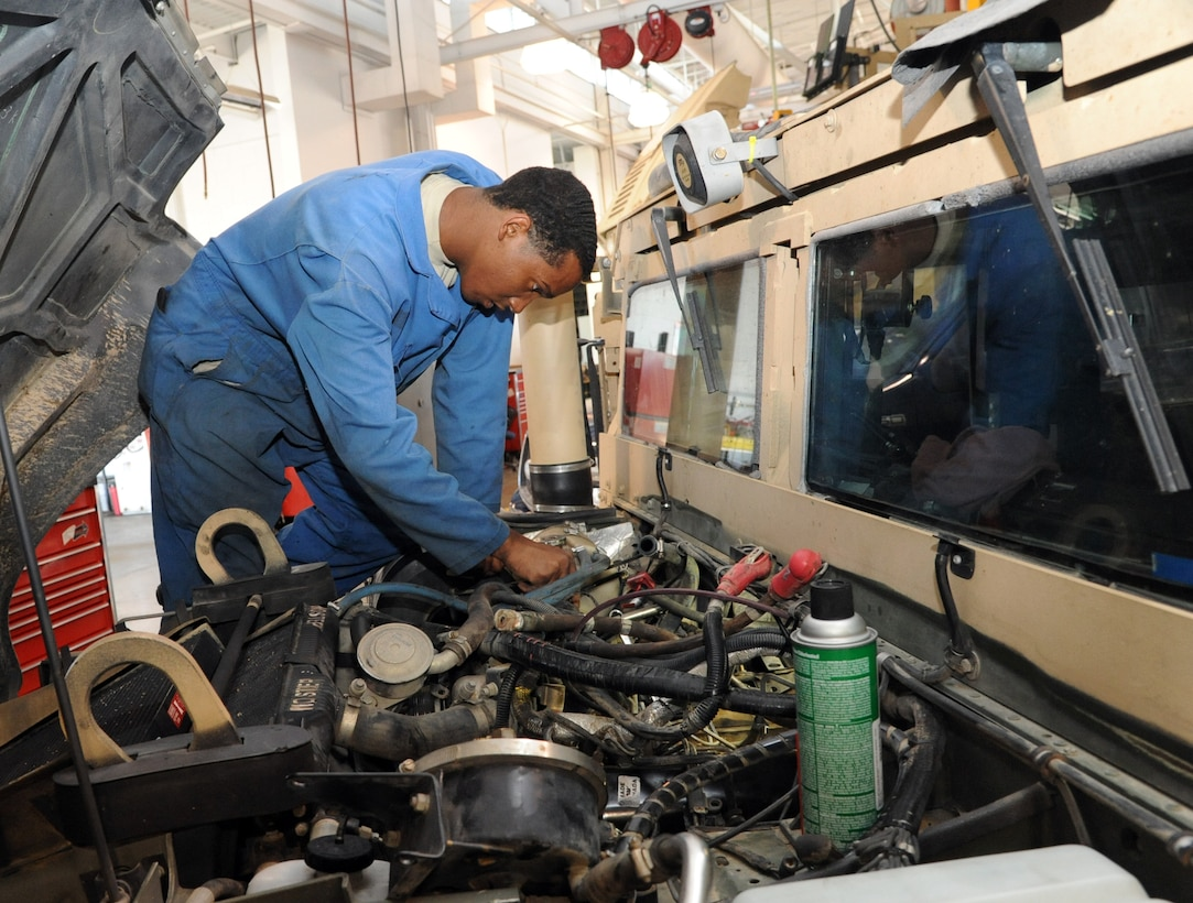 Airman 1st Class Latrelle Jones, 341st Logistics Readiness Squadron vehicle maintenance journeyman, replaces a passenger side valve cover gasket/intake gaskets and turbo charger seals on a 6.5-liter diesel engine July 23. Although the vehicle maintenance shop does work on multiple squadrons' vehicles, their main mission is to support security forces. (U.S. Air Force photo/Airman 1st Class Joshua Smoot)